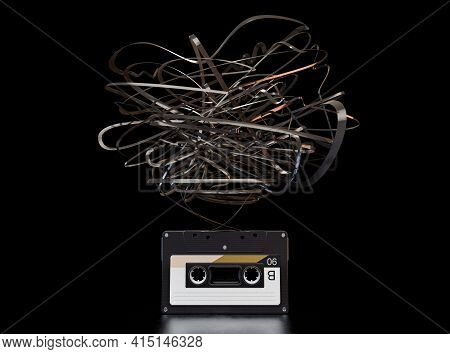 A Concept Showing A Vintage Audio Cassette Tape With A Floating Unravelled Ribbon An Isolated Dark B