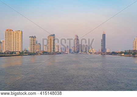 Bangkok City Skyline By Chao Phraya River In Thailand. Financial District And Skyscraper Buildings.