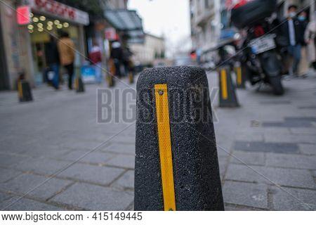 Stone Bollards Near Pavement To Prevent Cars Going Sidewalks Of Pedestrians In Urban Area