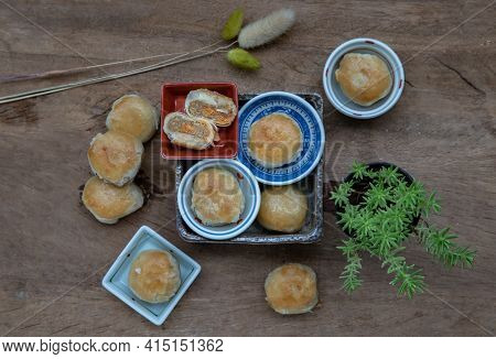 A Traditional Asian Pastry Or Tao Sor On Rustic Wooden Table. Chinese Sweet Pastry Filled With Mung