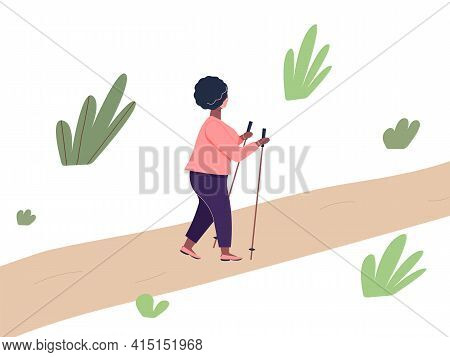 Elderly African Woman Is Engaged In Nordic Walking With Sticks On Path In The Park. Old Plump Fashio