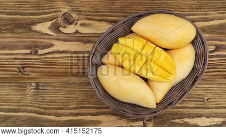 Ripe Barracuda Mango On A Wooden Table.