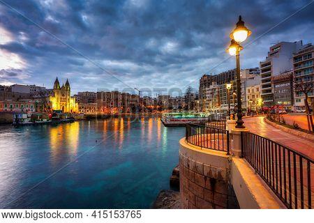 St. Julian's, Malta - January 11, 2019: Night scenery of St. Julian's town on Malta. This is very popular tourist destination on Malta.