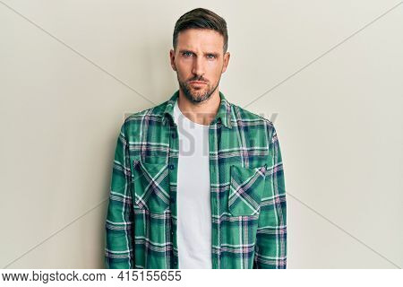 Handsome man with beard wearing casual clothes skeptic and nervous, frowning upset because of problem. negative person.