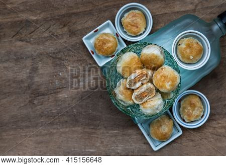 A Traditional Asian Pastry Or Tao Sor In Vintage Green Glass Bowl. Chinese Sweet Pastry Filled With