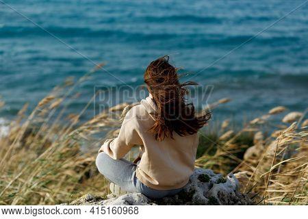 Young Yoga Woman Meditation, Mindfulness On Seaside Rock Cliff Edge. Beautiful Sea View
