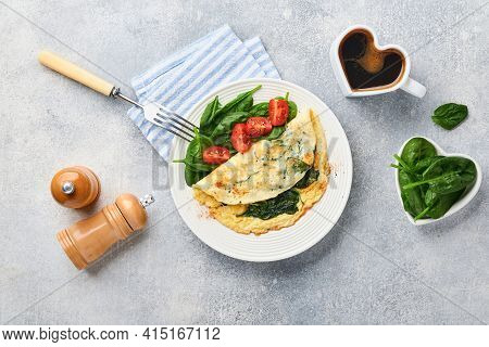 Omelet Or Omelette With Spinach, Cherry Tomato And Pepper Seasoning On A White Plate, On Light Grey
