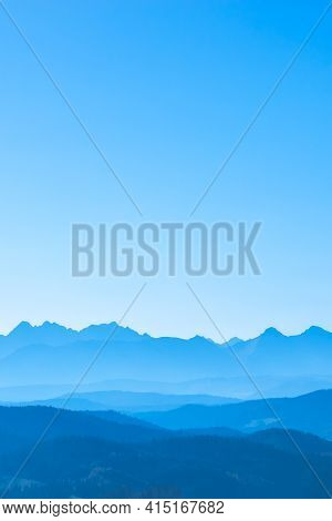 Blue Surreal Mountains Against The Backdrop Of A Cyan Sky, Fantastic Fairytale Mountain Landscape
