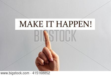 The Woman's Index Finger Of The Hand Is Directed To The Sign With The Inscription - Make It Happen!.