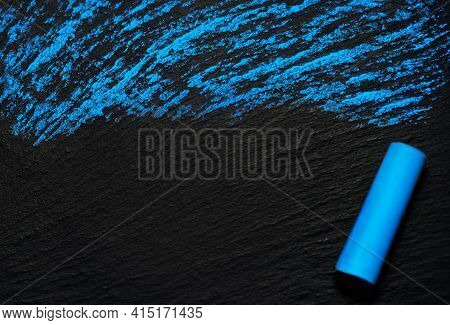 Blue Chalk On A Black Rough Board. A Simple Image As A Background With Blank Space For Text And Blue