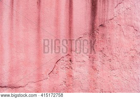 The Old Pink Floor Is Stained And Dirty From The Black Stains. Dirty Pink Plaster Wall For The Backg