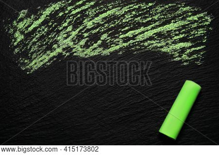 Green Chalk On A Black Rough Board. A Simple Image As A Background With Blank Space For Text And Gre