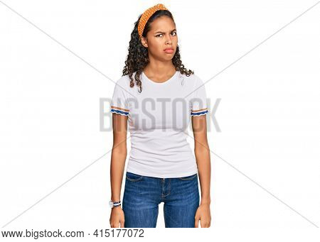 Young african american girl wearing casual clothes skeptic and nervous, frowning upset because of problem. negative person.