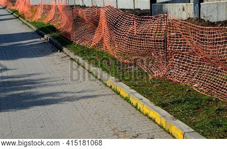 A Plastic Safety Net Is Intended To Prevent People From Entering The Construction Site. It Is A Chea