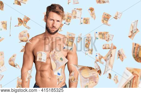 Young caucasian man standing shirtless skeptic and nervous, frowning upset because of problem. negative person.