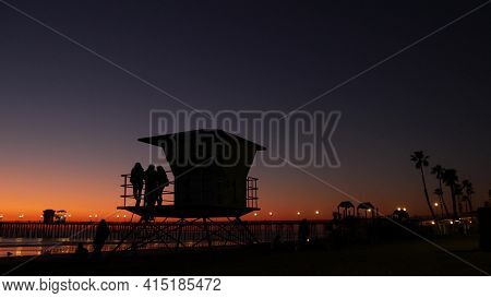 Oceanside, California Usa - 8 Feb 2020: Young Teen Girls Near Lifeguard Tower, Friends On Pacific Oc