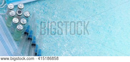 Medical Instruments On Blue Background. Banner With Medical Items. Medical Mask And Vaccine. Ampoule