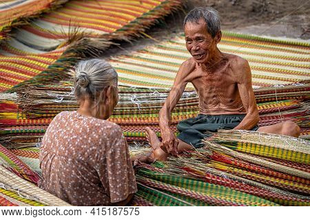 Top View Of Old Vietnamese Lover Craftsman Making The Traditional Vietnam Mats With Happiness Action