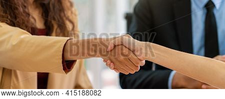 Banner Of Closeup Handshake When Interview Between Young Asian Woman And Two Manager With Positive M