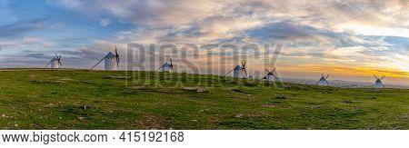 Panorama View Of The Historic White Windmills Of La Mancha Above The Town Of Campo De Criptana At Su