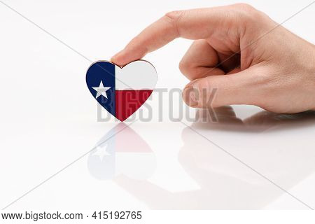 Texas State Flag. Love And Respect Texas. A Man's Hand Holds A Heart In The Shape Of The Texas Flag