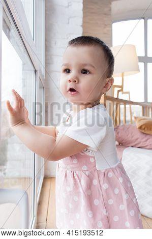 Little Girl Looks Out The Window, Wonders