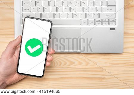 Cell Phone Confirmation. Smartphone With Green Checkmark On Screen, Validated, Confirmed, Completed,