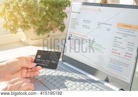 Online Payment For Purchases By Credit Card. Woman Doing Online Shopping With Laptop And Credit Card