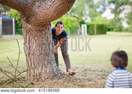 Mother And Little Eastern Handsome Baby Boy Playing Outdoor In The Park. Happy Mixed Race Family Con