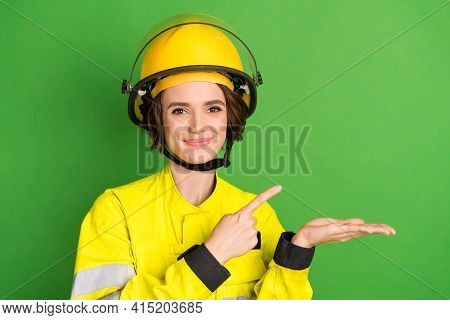 Photo Of Young Woman Firefighter Happy Positive Smile Point Finger Product Promo Suggest Isolated Ov