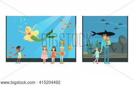 People Visiting Oceanarium, Visitors Watching Underwater Scenery With Sea Animals And Mermaid At Exc