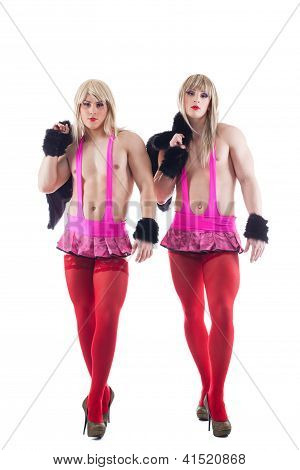 Two transvestites in pink costumes isolated