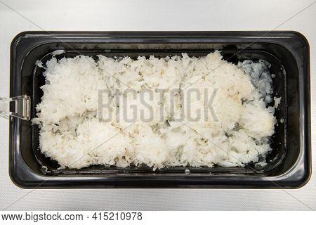 Marinated snow fungus korean salad in plastic container