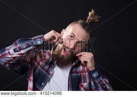 Young Man With Bushy Beard And Stylish Haircut Twirls Long Mustache With Dreamy Emotion
