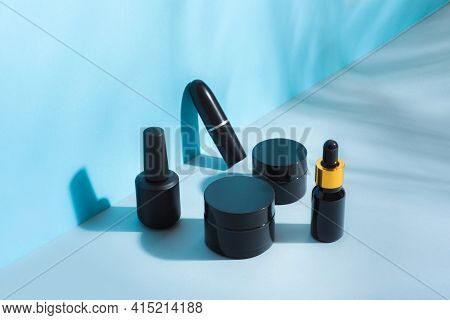 A Set Of Cosmetic Packages Of Black Color, Different Sizes, Clean, Black Without Labels, Cream, Lips
