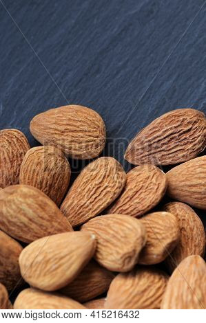 Almond Nut. Raw Almonds Nuts On Black Slate Background.nuts And Seeds Closeup.tasty Snack. Healthy F