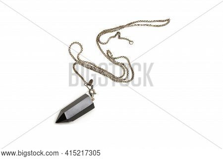 Pendulum On Silver Chain Of Black Onyx. Isolated White Background.
