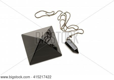 Items Of Magic From Black Onyx. Pyramid And Pendulum. Isolated White Background.