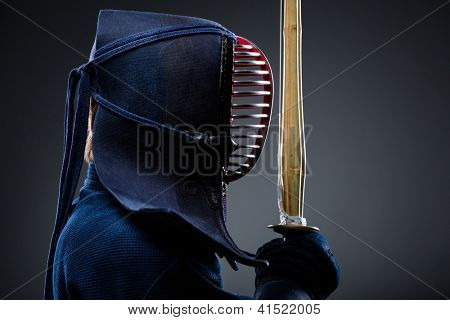 Profile of kendo fighter with shinai. Japanese martial art of sword fighting