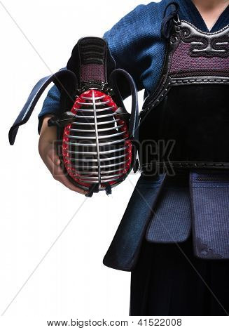 Close up of kendo helmet in hands of kendo fighter, isolated on white. Japanese martial art of sword fighting