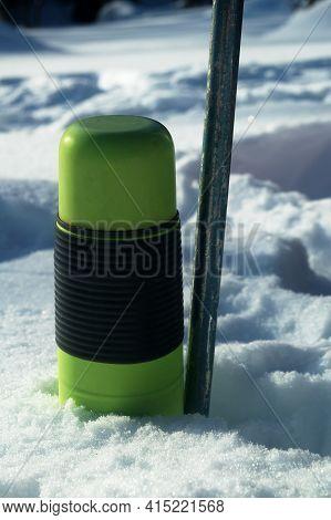 Ski Pole And Thermos In The Snow. Halt. Halt