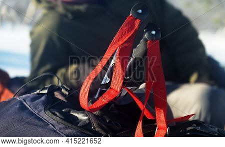 Ski Poles And Backpack. A Halt On The Ice, Group Of Skiers With Large Backpacks Crosses A Frozen Lak