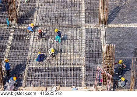 Construction Workers Fabricating Large Steel Bar Reinforcement Bar At The In Construction Area Build