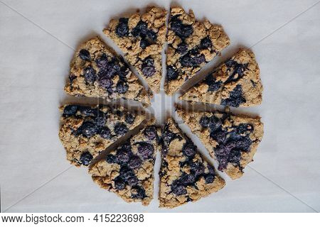 Freshly Baked Oat Blueberry Scones On Baking Paper On White Wooden Background. Sweet Food With Natur