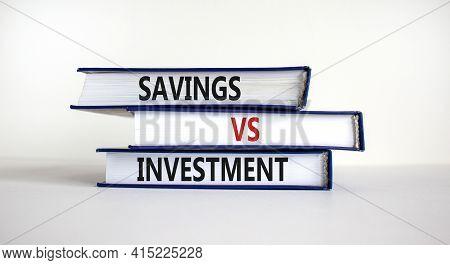 Savings Vs Investment Strategy Symbol. Books With Words 'savings Vs Investment'. Beautiful White Bac