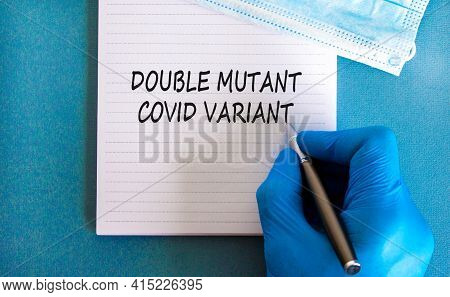 Covid-19 Double Mutant Symbol. Doctor Hand In Blue Glove With White Note. Concept Words 'double Muta