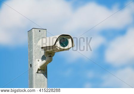 Cctv Surveillance Security Camera Video Installed On A Iron Pole With A Blue Sky And Clouds In The B