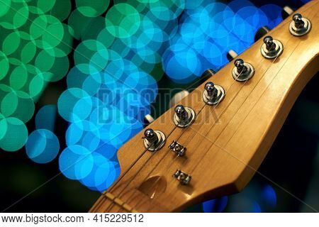 Wooden Guitar Headstock On The Bokeh Background