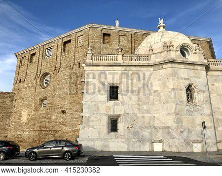 Cadiz, Spain - December 25, 2019: The Monumental Cadiz Cathedral In A Sunny Day
