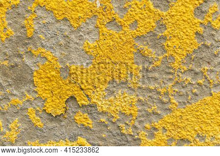 Old Wall With Yellow Peeled Weathered Paint. Abstract Textured Background